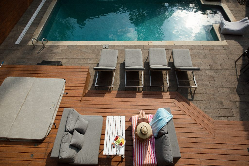 four gray loungers near pool